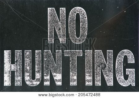 No hunting sign, black and white old vintage no hunting sign
