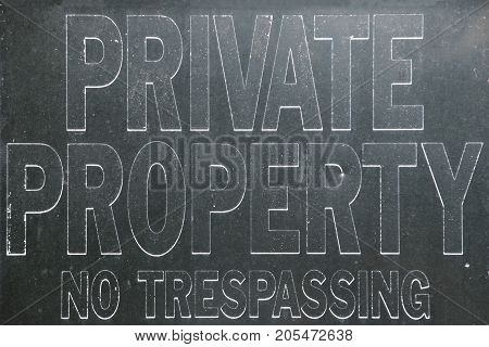 Old vintage private property no trespassing sign, black and white