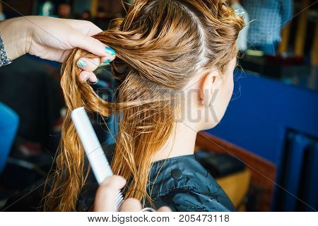 attractive woman in hair salon making new haircut
