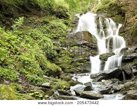 Mountain waterfall landscape waterfall like a background a backdrop