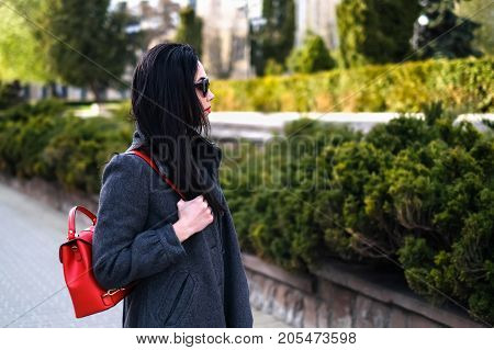 Woman On The Street With Red Backpack