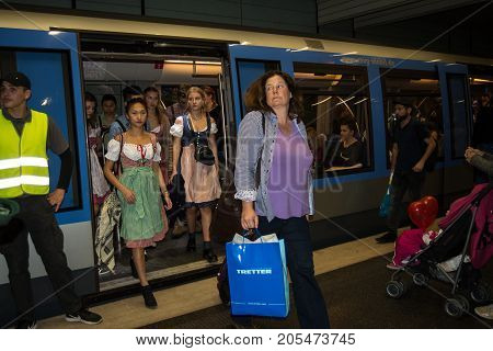 MunichGermany-September 242017: People in typical bavarian costumes exit a subway train at a station near the Oktoberfest grounds