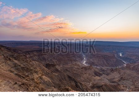 Fish River Canyon, Scenic Travel Destination In Southern Namibia. Last Sunlight On The Mountain Ridg
