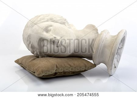 Sleeping Venus (gypsum woman head on pillow)