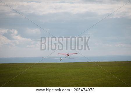 Sailplane And A Towing Aircraft Starting On An Airfield England