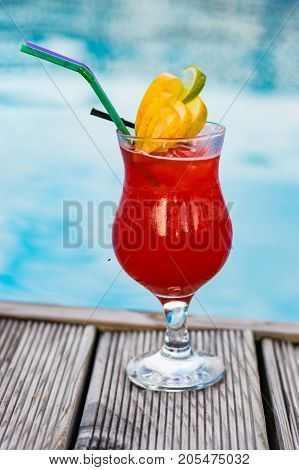 Glass With Coctail With Fruits Near The Pool