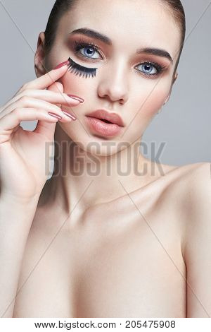 False Eyelashes On The Eyes. Increase In Volume Of Eyelashes, Cosmetics Eyes. Professional Eye Makeu