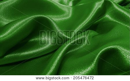 Realistic flag of Libya on the wavy surface of fabric. This flag can be used in design