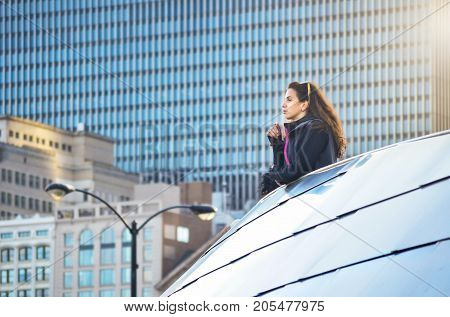 Female Tourist Looking At Chicago Cityscape