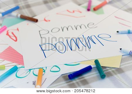 French; Kids Writing Name Of The Fruits For Practice
