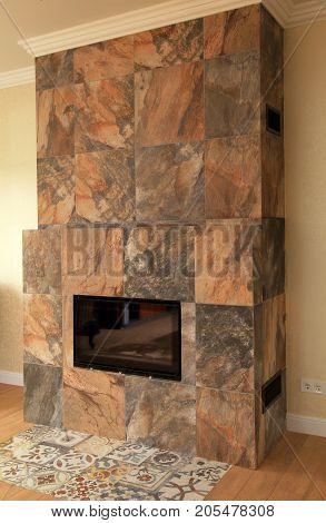 Contemporary fireplace built with stone tile in living room of modern home