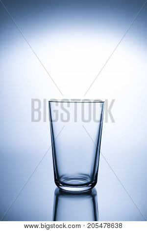 Empty transparent glass for  water with reflection
