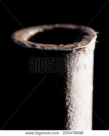rusty pipe on black . Photo of an abstract texture