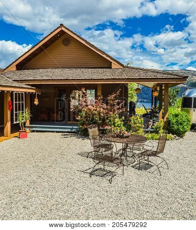 Outdoor cafe on road side close to waterfront of Okanagan lake with view to the mountains