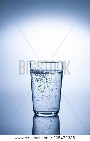 A glass of mineral water with reflection
