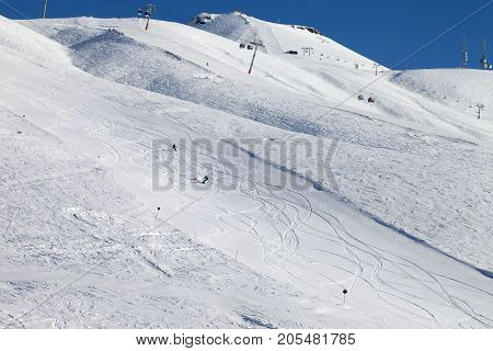 Snowboarders Downhill On Ski Slope