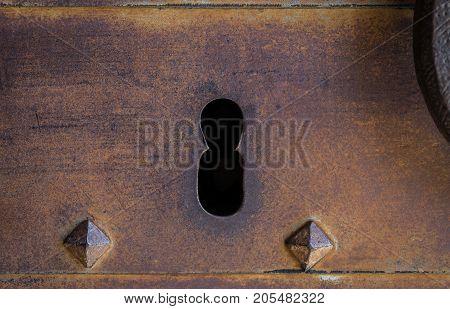 Closeup vintage door lock of external rusty iron