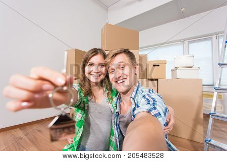 Happy couple moving in a new house indoor