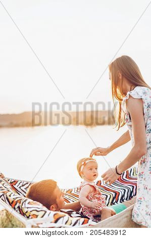 Cute Little Baby Girl With Her Parents On A Weekend Getaway, Happy Mother Caressing Daughter, Father