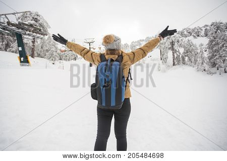 Freedom woman enjoying the outdoors, watching winter landscape