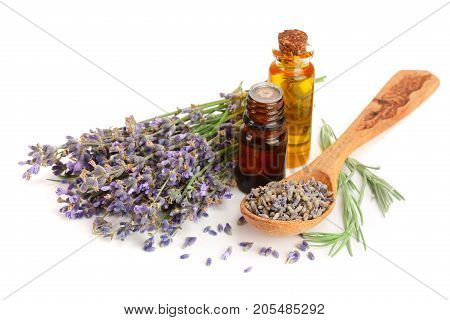 Bottle with aroma oil and lavender flowers isolated on white background.