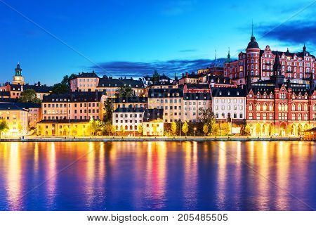 Scenic evening view of the Old Town pier architecture in Sodermalm district of Stockholm, Sweden
