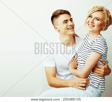 young pretty teenage couple, hipster guy with his girlfriend happy smiling and hugging isolated on white background, lifestyle people concept close up