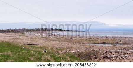 Natural empty beach Spring in New-Brunswick Canada