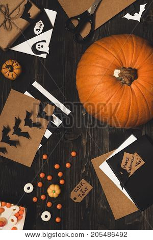 Halloween Pumpkin, Sweets, Halloween Cards And Decoration Made Of Craft Paper On The Wooden Table