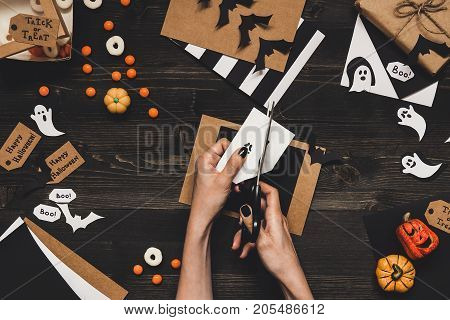 Halloween Preparation. Hands Making Halloween Cards And Decoration Using Craft Paper