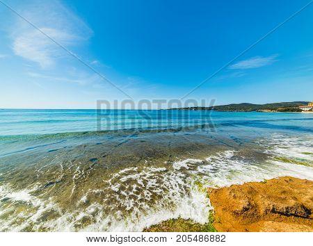 Blue sky over Le Bombarde beach Sardinia