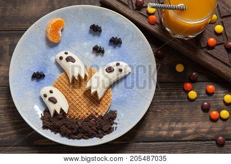 Scary halloween food edible banana ghosts with waffle