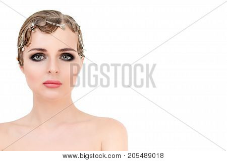 Portrait of elegant blonde retro woman with beautiful hair and smokey eyes makeup. Vintage and glamour beauty style, sensual european young model posing in studio. Free copy space