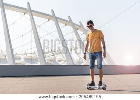 Full length portrait of outgoing teenager going on digital device. Modern technology concept. Copy space