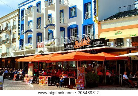 Albufeira Algarve Portugal - October 316 2015 : Tourists eating and drinking in restaurants in the old town of Albufeira Portugal