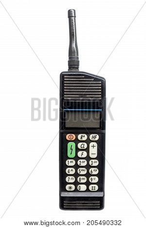 Old cellular phone against white isolated background