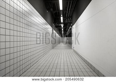 Black and White empty corridor angle shot