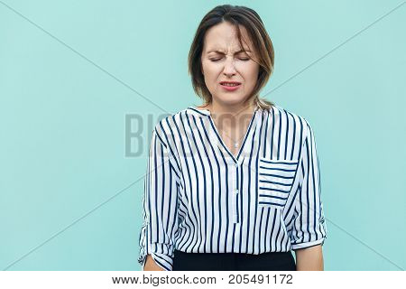 Portrait Of Unhappy And Depressed Woman With Blonde Hair Feeling Ashamed Or Sick, Keeping Eyes Close