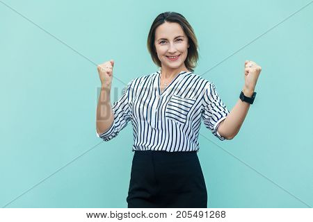 Businesswoman Rejoicing For His Success. Isolated On Light Blue Background.