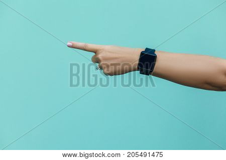 Look This! Hand Finger Pointing Isolated On Light Blue Background.
