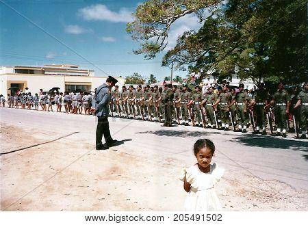 NUKU'ALOFA, TONGATAPU / TONGA - CIRCA 1990: Tongan soldiers stand at attention to watch a parade during a national holiday.