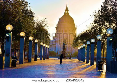 September 17, 2017 in San Francisco, CA:  City Hall Building beside a courtyard surrounded by manicured landscaping taken in San Francisco, CA where people can relax in this plaza and walk to the City Hall Building which is open to the public