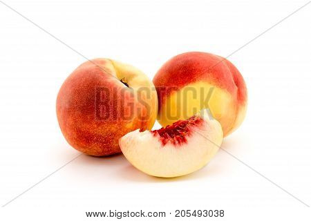 Peaches on a white background closeup. Of ripe fruit.