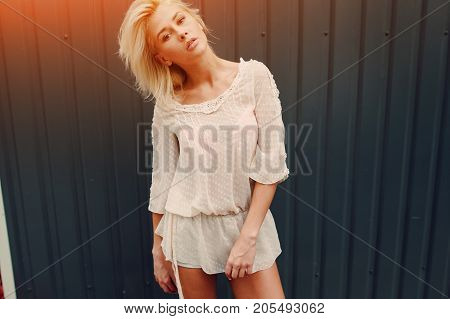beautiful young blonde posing with the freedom and ease of movement