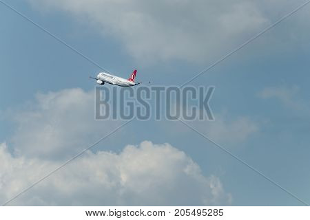 Duesseldorf Germany 03, .09.2017: Turkish Airlines Airbus A320-232 departing runway takeoff blue cloudy sky