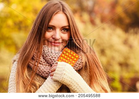 Woman In Autumn Park Holding Vitamins Medicines