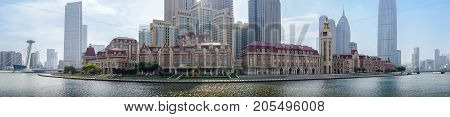 Tianjin, China - Nov 1, 2016: Commercial skyline across the Haihe River. Buildings in contrasting modern and old architectural style. A panorama view from Tianjin Railway Station.