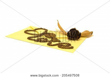 Vintage envelope with key and chain, isolated