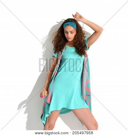 Young happy beautiful sexy woman posing in mint and pink fashion body dress cloth on a white background