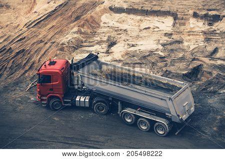 Sandy Construction Site Large Dump Truck. Moving Dirt.